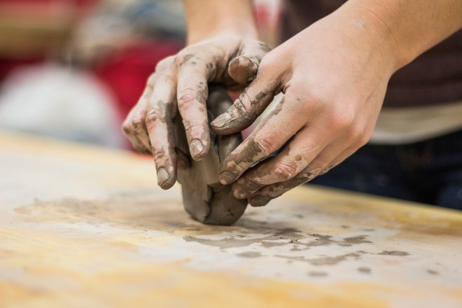 hands-forming-clay